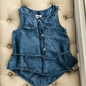 Sleeveless buttons up top with 2 small pockets
